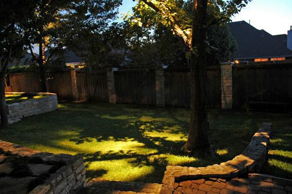 Atlanta landscape lighting fixtures are aimed away from observers and camouflaged by placing the accent lights behind shrubbery to preserve a natural looking landscape mozeypictures Images
